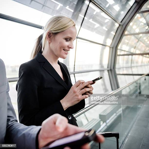 Businesswoman With Smart Phone At Airport