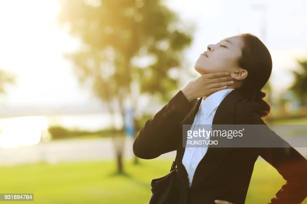 Businesswoman with sore throat