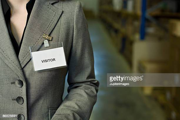 Businesswoman with visitor badge
