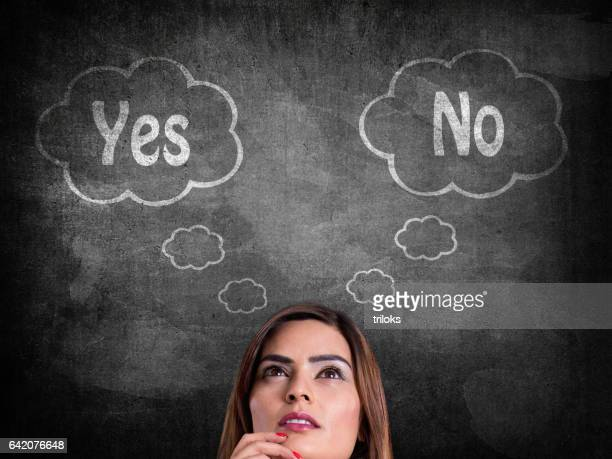 businesswoman with yes or no choice - quotation text stock photos and pictures
