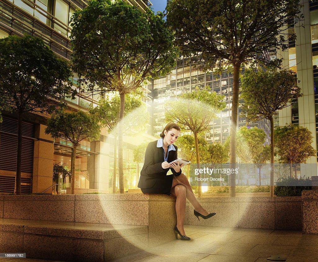 Businesswoman within virtual sphere : Stock Photo