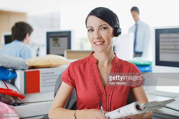 Businesswoman working at desk in headset