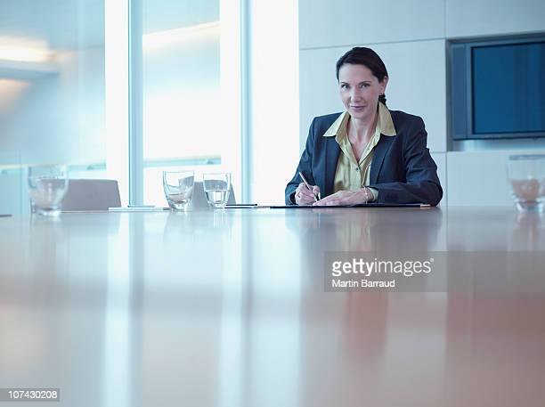 Businesswoman working at office conference table
