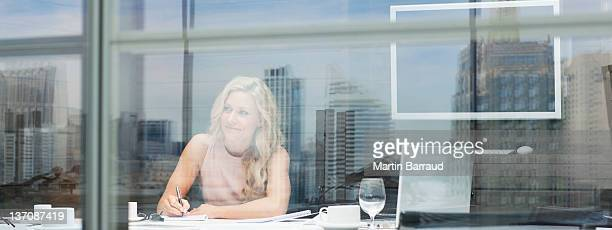 Businesswoman working at table in conference room