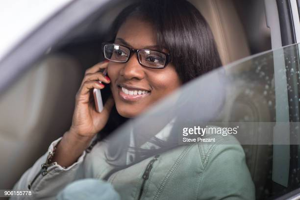 Businesswoman working from car