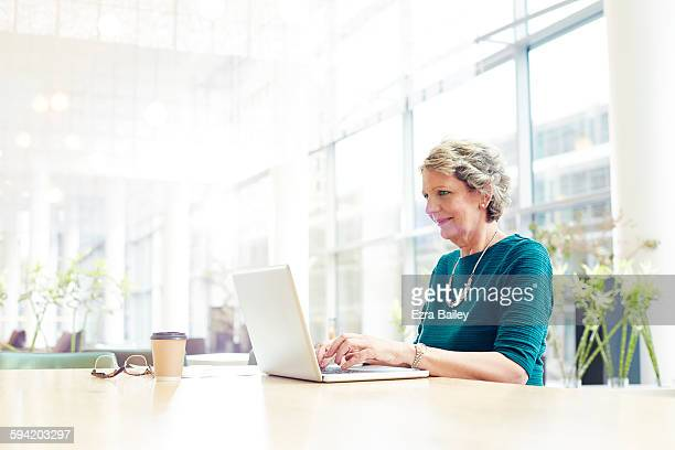 Businesswoman working in a modern office.