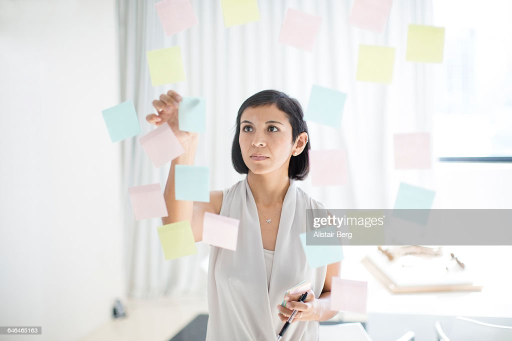 Businesswoman working in an office : Foto de stock