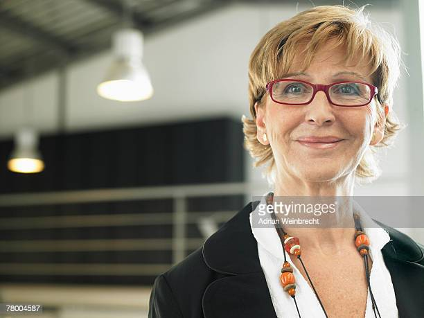 businesswoman working in an office - hot older women stock pictures, royalty-free photos & images
