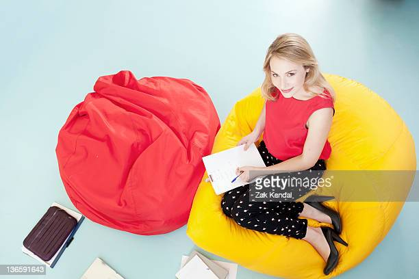 Businesswoman working in bean bag chair