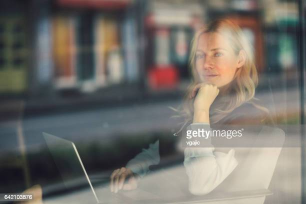 businesswoman working in cafe - looking through window stock pictures, royalty-free photos & images