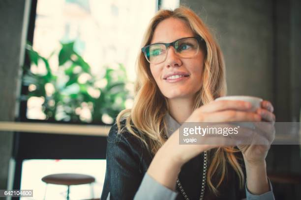 businesswoman working in cafe - 35 39 years stock pictures, royalty-free photos & images