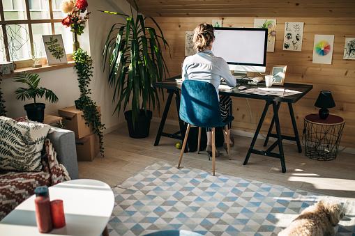 Businesswoman Working In Creative Office 1136856526