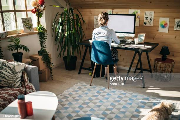 businesswoman working in creative office - back to work stock pictures, royalty-free photos & images