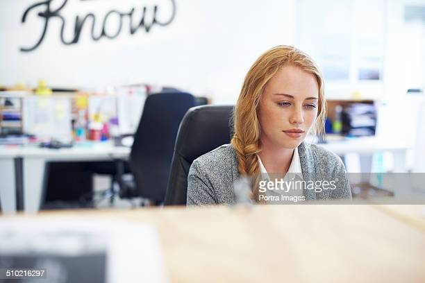 Businesswoman working in creative office