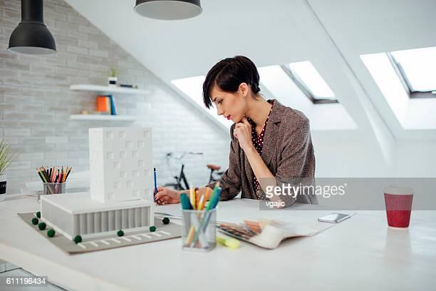 Businesswoman Working In Her Office.