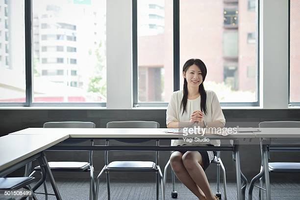 Businesswoman working in meeting room