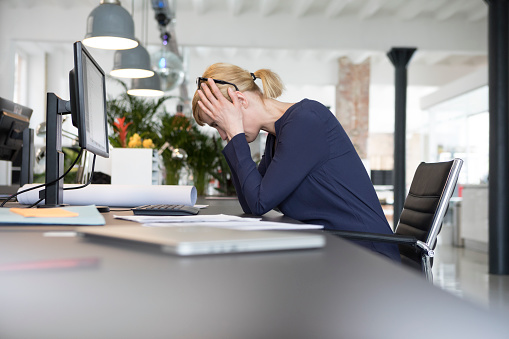 Businesswoman working in office, being stressed out - gettyimageskorea