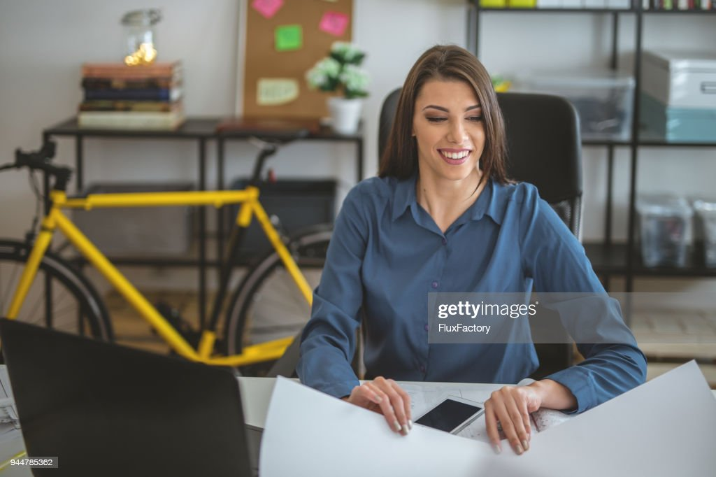 Businesswoman working in the office : Stock Photo