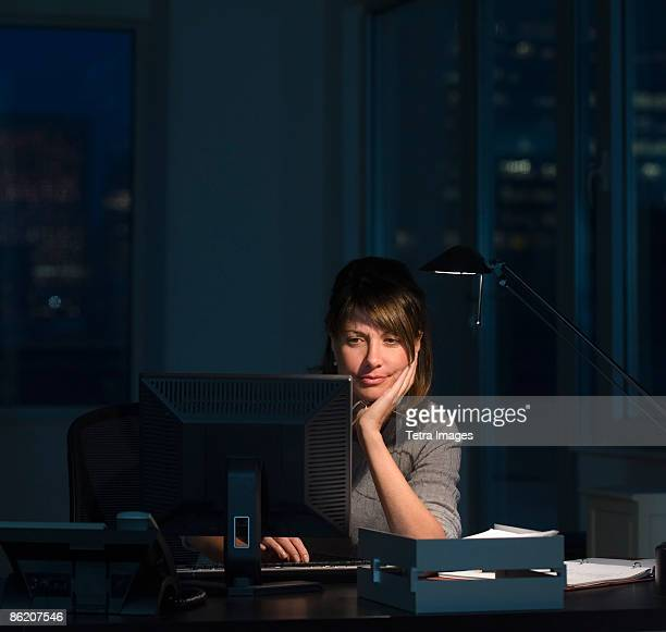 businesswoman working late in office - one mature woman only stock pictures, royalty-free photos & images