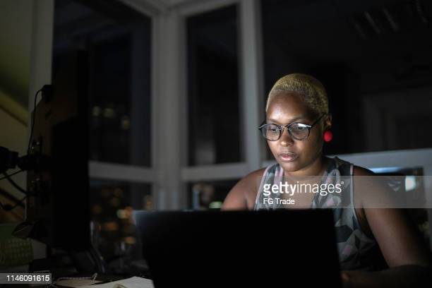 businesswoman working late in the office - part of a series stock pictures, royalty-free photos & images