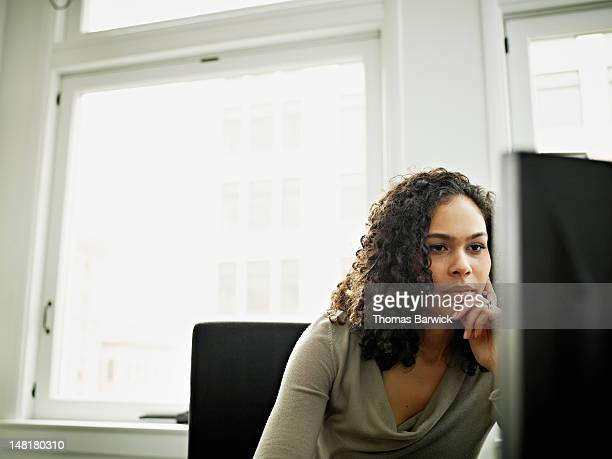 businesswoman working on computer at workstation - leanincollection stock pictures, royalty-free photos & images