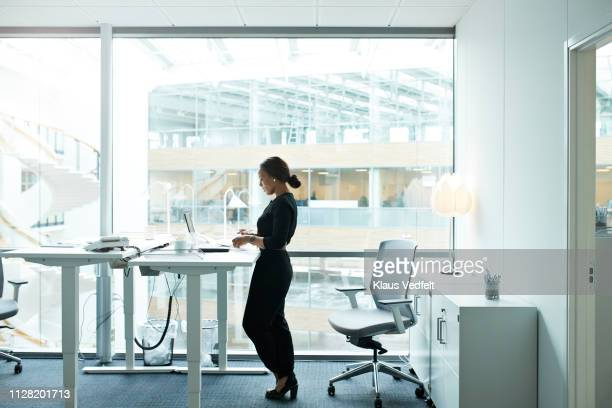 businesswoman working on computer in office - ergonomics stock photos and pictures