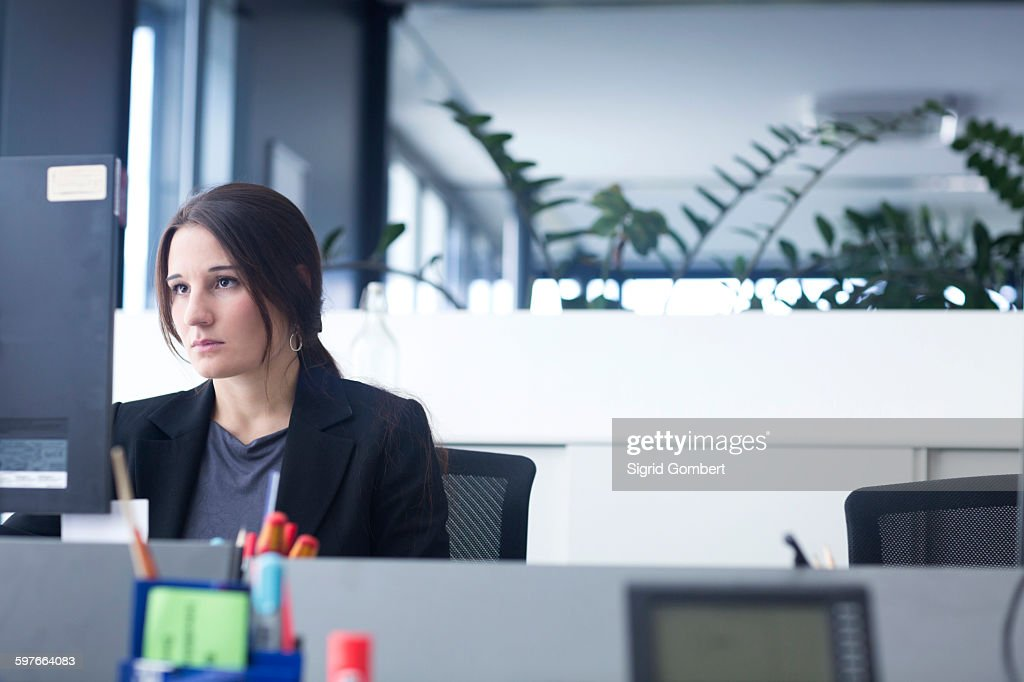 Businesswoman working on computer in office : Stock-Foto