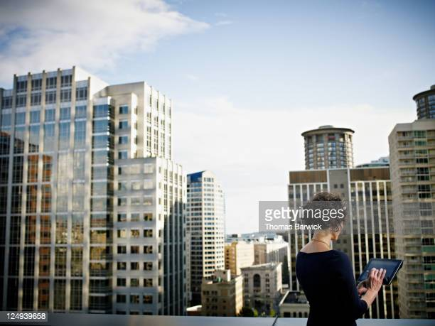 businesswoman working on digital tablet on deck - world at your fingertips stock pictures, royalty-free photos & images