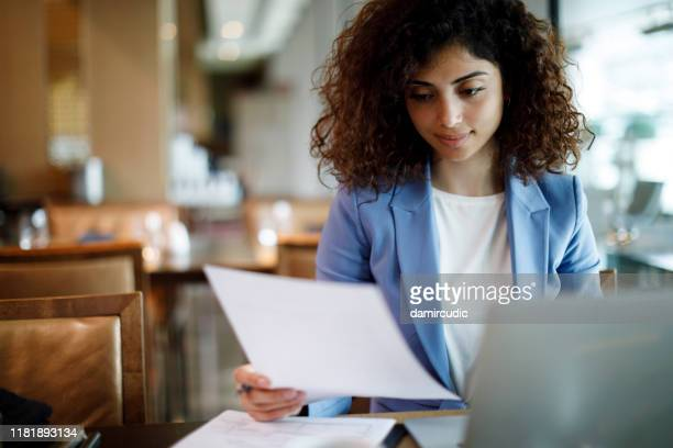 businesswoman working on laptop at a cafe - big data management stock pictures, royalty-free photos & images