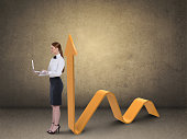 businesswoman working laptop successful business graph