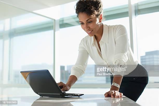 Businesswoman working on laptop in office