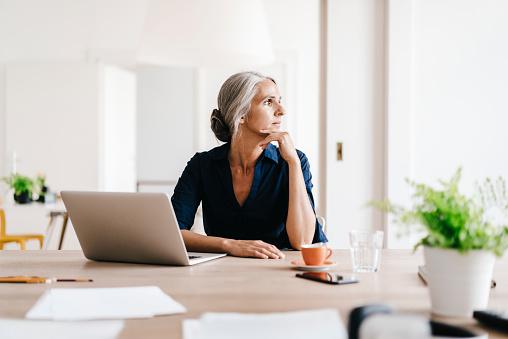 Businesswoman working on laptop in office - gettyimageskorea