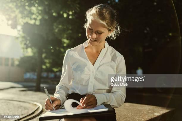 Businesswoman working on presentation.
