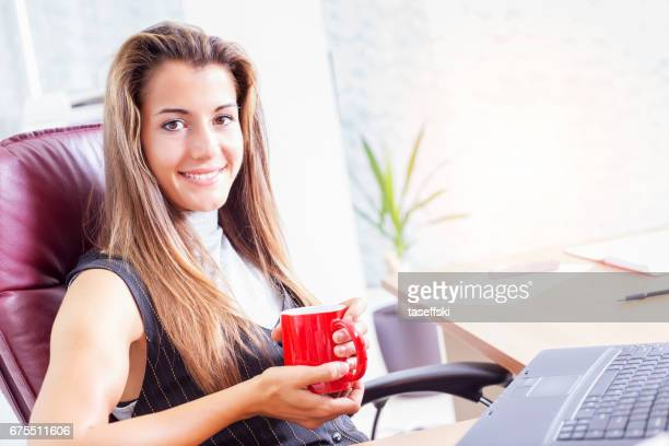 Businesswoman working online at office