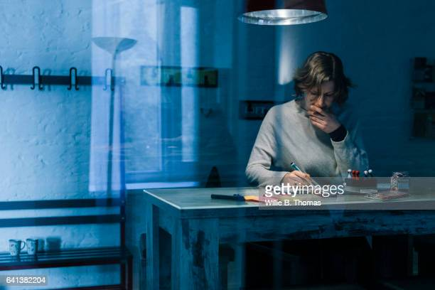 businesswoman working overtime - persistence stock pictures, royalty-free photos & images