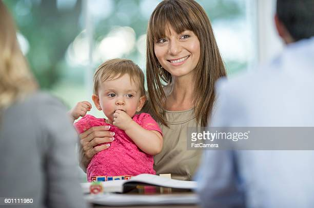 Businesswoman Working While Watching Her Daughter