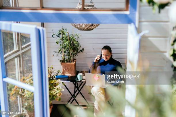 businesswoman working with laptop in garden house outdoor. - guido mieth stock pictures, royalty-free photos & images