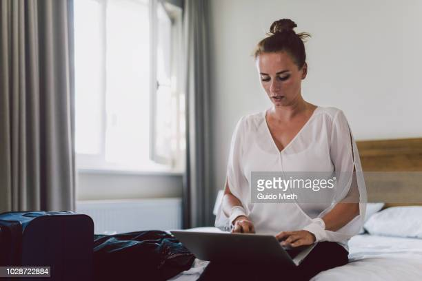 Businesswoman working with laptop in hotelroom.