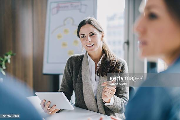 businesswoman working with tablet - employee engagement stock pictures, royalty-free photos & images