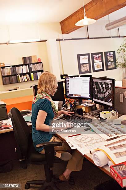 Businesswoman works at computer