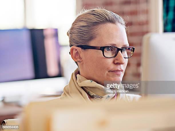 Businesswoman works on computer