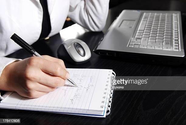 Businesswoman writing daily plan