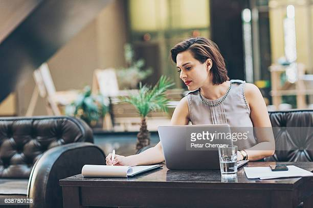 Businesswoman writing documents