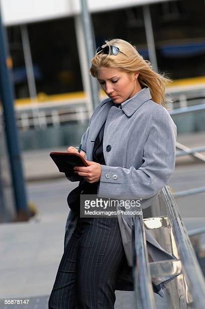 businesswoman writing in an organizer - fully unbuttoned stock pictures, royalty-free photos & images