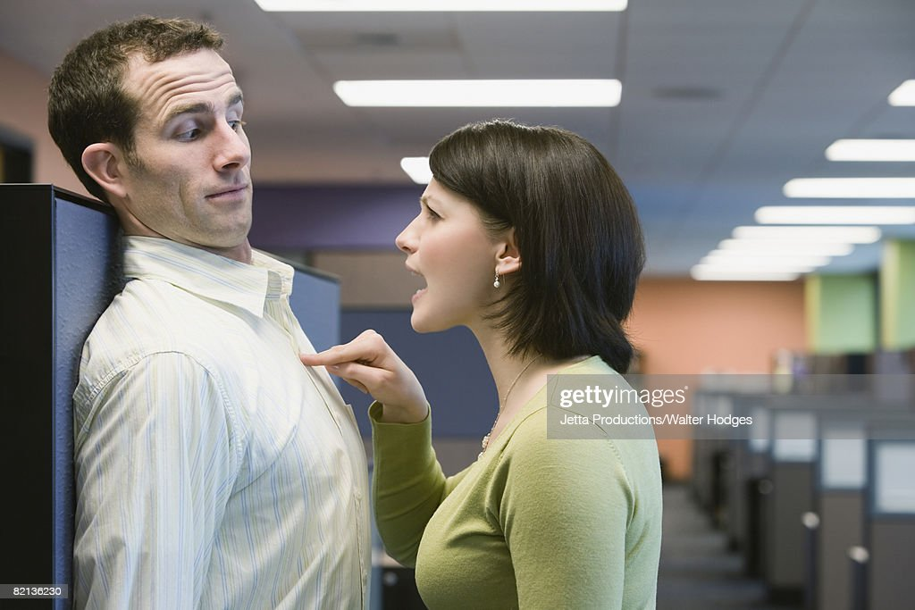 Businesswoman yelling at businessman : Stock Photo
