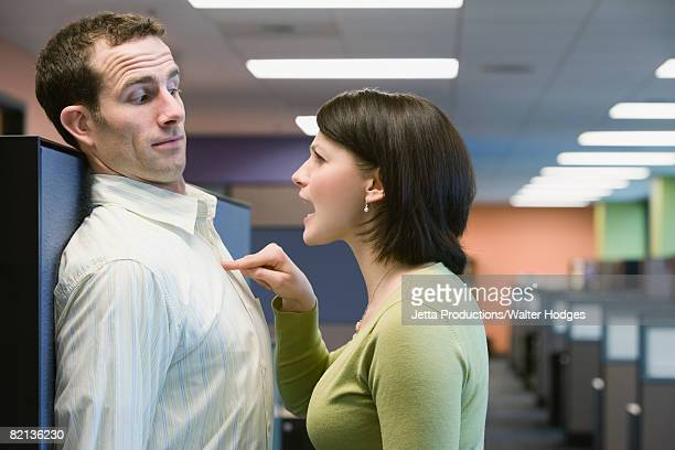 Businesswoman yelling at businessman