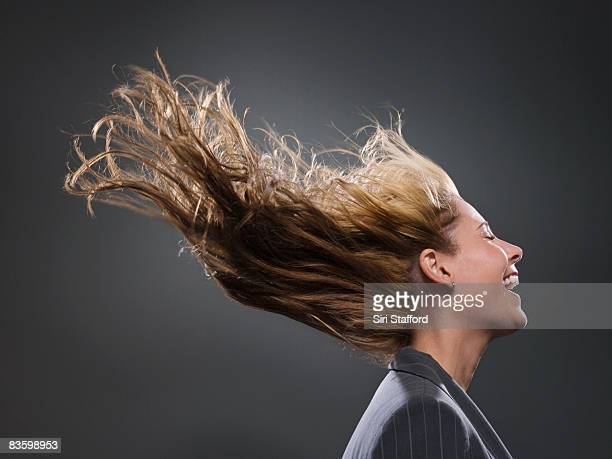 Businesswoman's hair blowing in wind