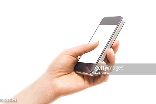 Businesswoman's hand using mobile phone