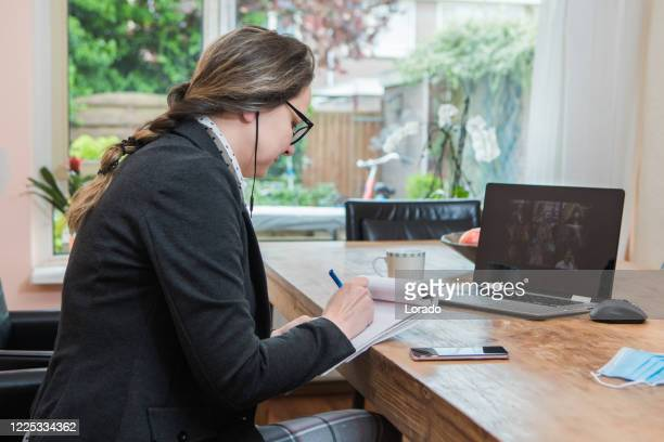 businesswoman's home office set up for webinar and teleconference - live broadcast stock pictures, royalty-free photos & images