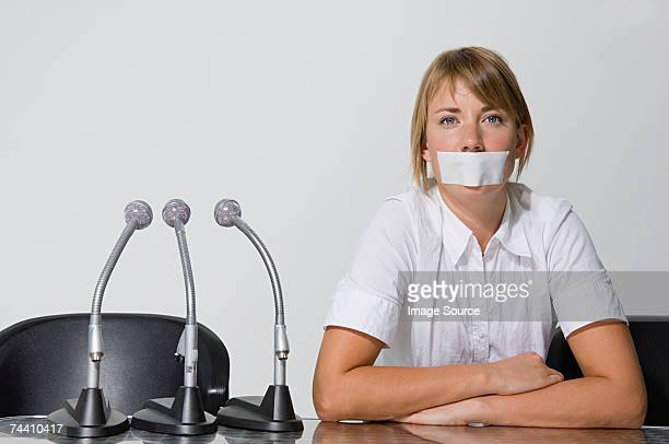 businesswoman's mouth covered with a plaster - gagged woman stock pictures, royalty-free photos & images